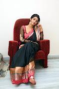Nidhi Natuiyal Glamorous Photos in Saree-thumbnail-10