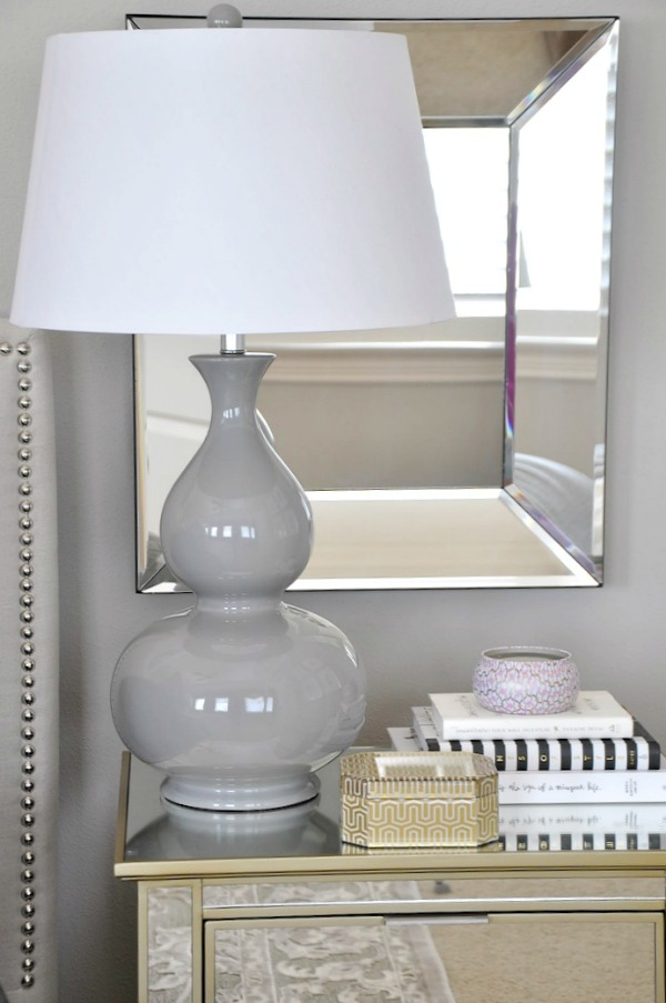 neutral master bedroom,  gray lamp and mirror accents