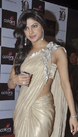 Priyanka Chopra at golden petal awards hosting wards night in her tight white desi girl saree underwear impression visible latest Priyanka Chopra hot pics