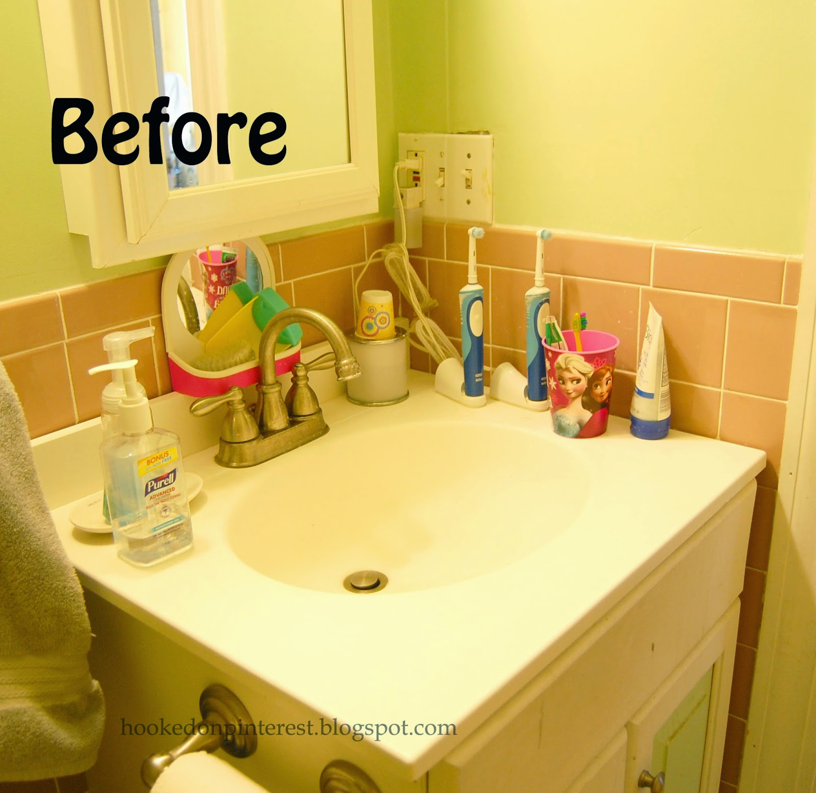 Hooked on pinterest easy velcro bathroom organization for Organizing my bathroom