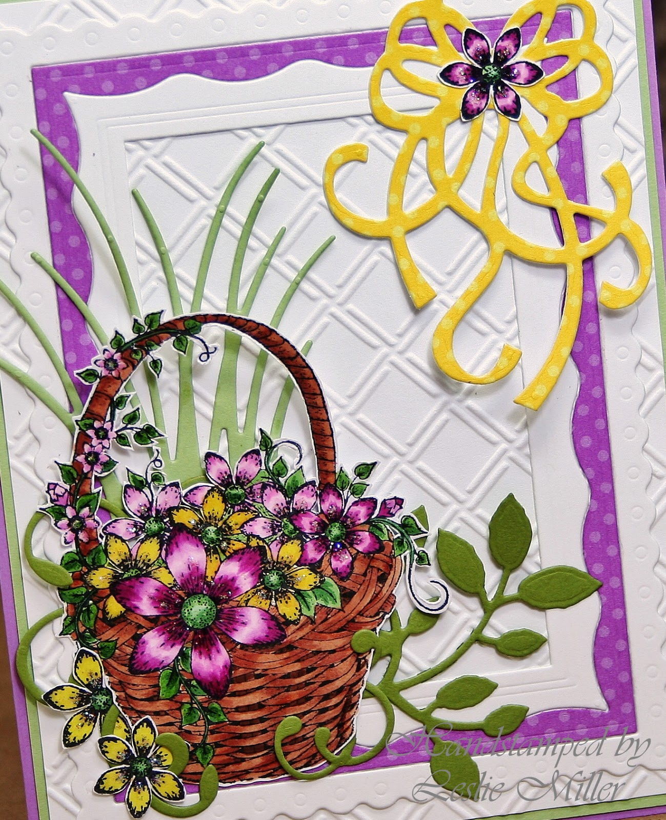 Dies r us a tisket a tasket a little flower basket i added a little glitter to the flowers too with all these pretty parts i didnt pop up a single thing or use any hardware on the card yet its loaded izmirmasajfo