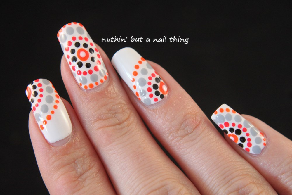Tribal polka dot nail art