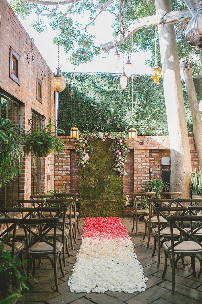 Outdoor garden ceremony with ombre aisle