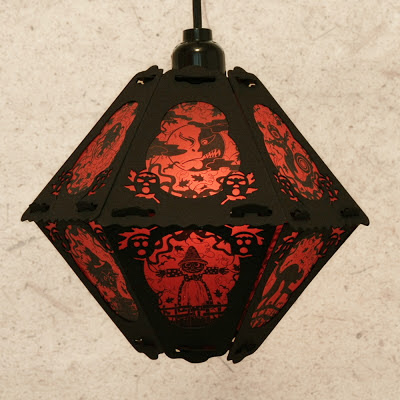 This limited edition paper lantern by Bindlegrim features red & black Halloween imagery