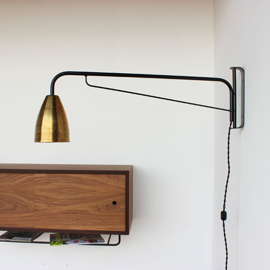 Handmade brass swing arm wall sconce by onefortythree
