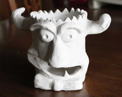 monster face sculpture unglazed