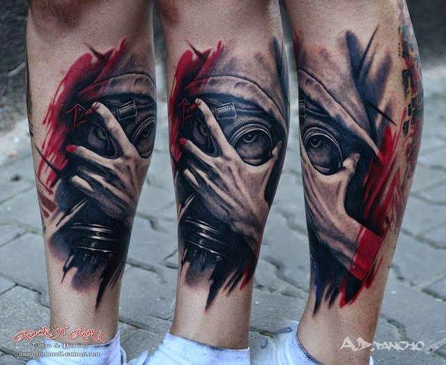 Realistic mask and hand tattoo on legs