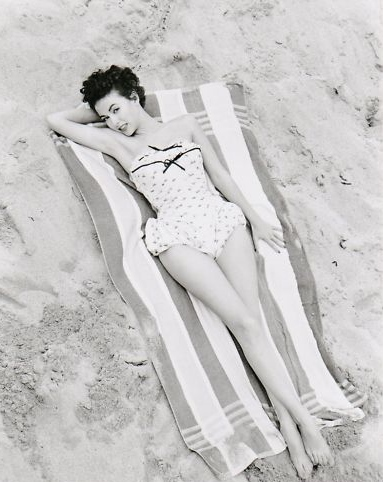 rita moreno on the beach, 1950s