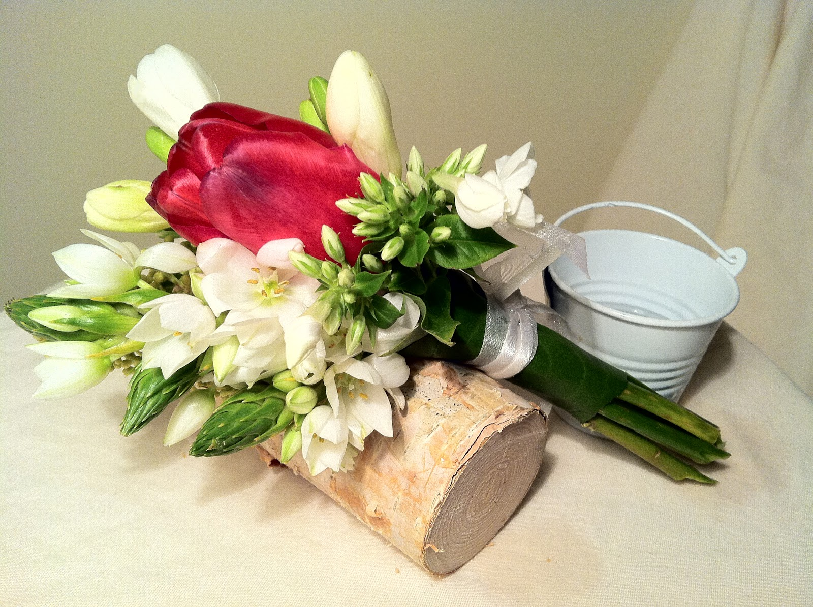 Mini wedding bouquet with one white rose and multipruposed this one can be used as a very small and light bouquet or as a nice fragrant corsage its also good for a table decoration on a spring themed wedding izmirmasajfo