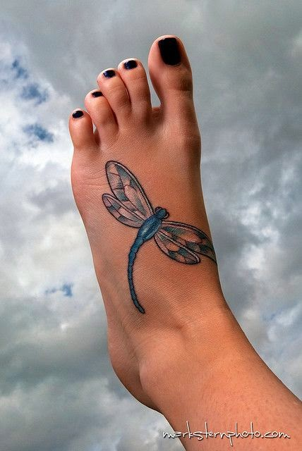 dragonfly foot tattoo.