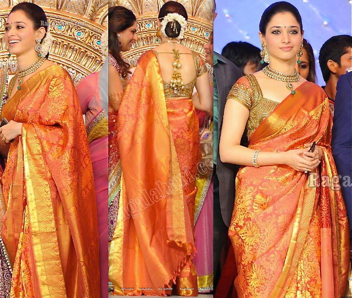 ... saree in orange color with gold zari all over the saree, paired up