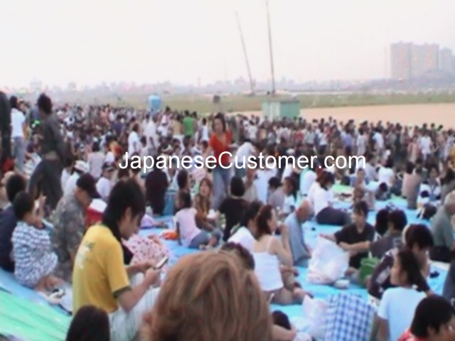 Japanese customers enjoy fireworks Copyright Peter Hanami 2014