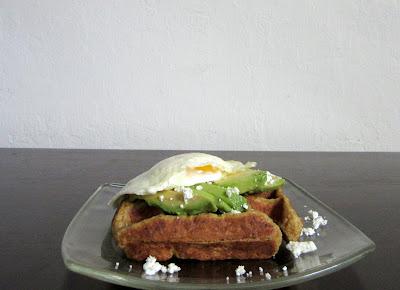 Pumpkin Spice Waffle topped with avocado, a fried egg and feta