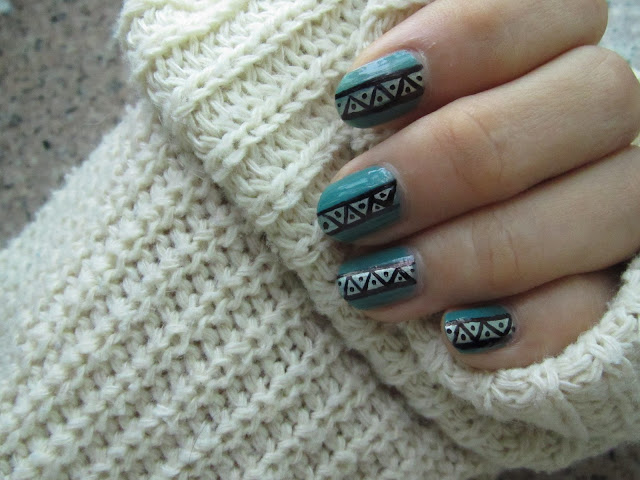 Gold details tribal nail design