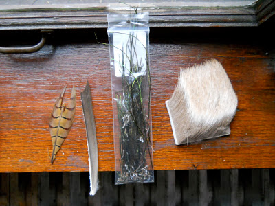 Various feathers, elk hair for fly tying