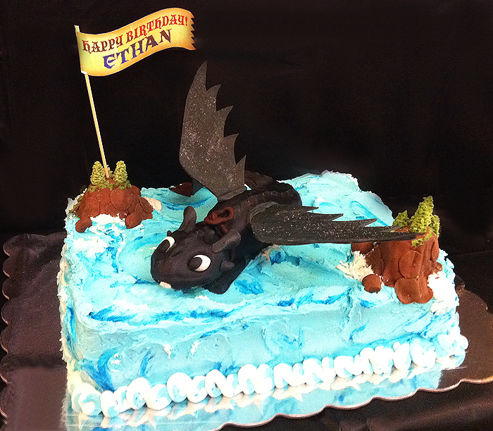 Sugarsong custom cakes how to train a birthday cake soaring into the party to wish the birthday boy a happy birthday is toothless aka the elusive night fury from the movie how to train your dragon ccuart Choice Image