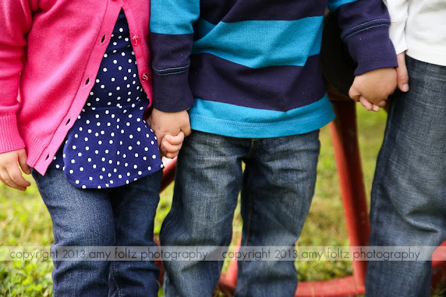 photo of siblings holding hands