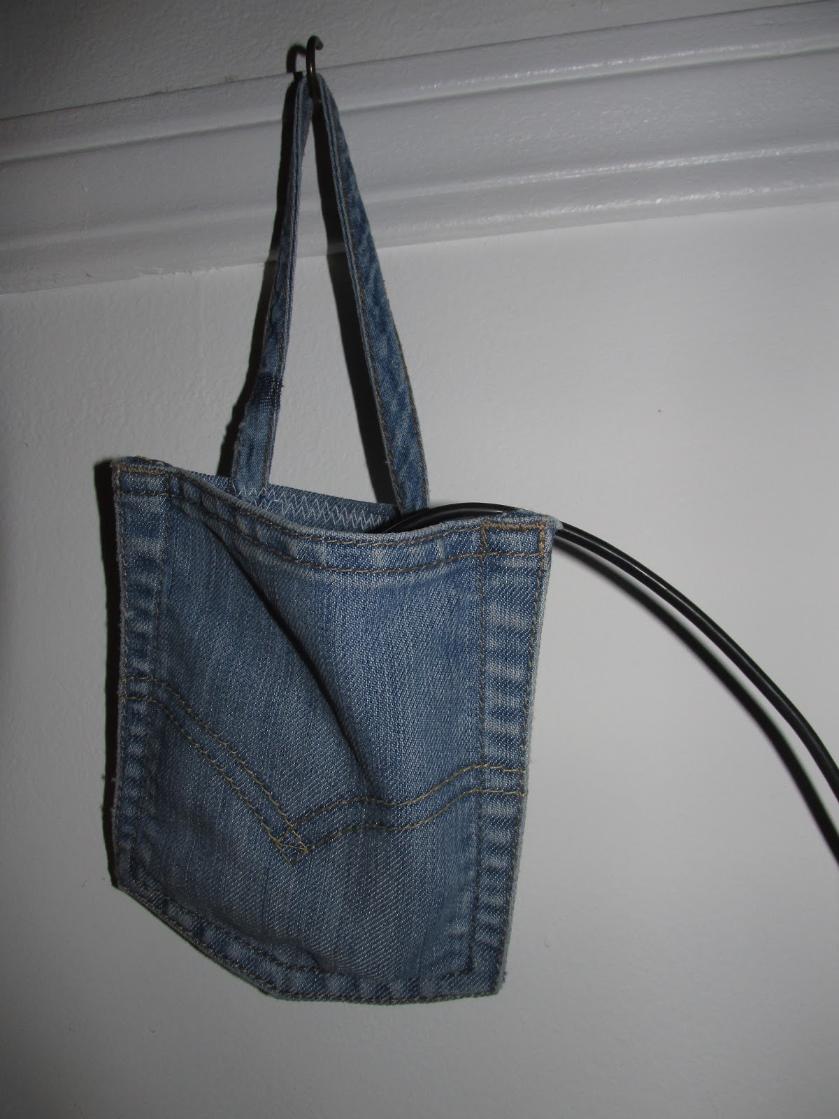 stuff blue jean pocket becomes charging station for wireless phone