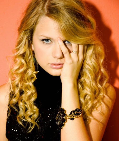 Taylor Swift wearing a Jenny Dayco bracelet and earrings