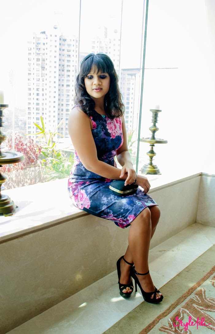 Dayle Pereira of Style File India wears a Miss Selfridge bodycon dress via Jabong paired with Zara stilettos, purple smokey eyes, beach waves and a minaudiere on the stairs
