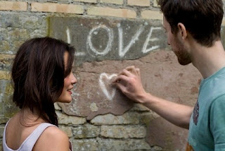 couple writing love on wall