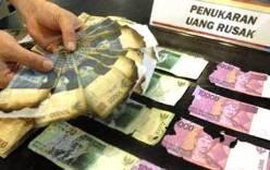 Limbah uang kertas rusak