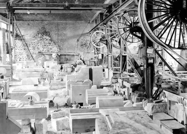 Easton, Bath and Portland Stone Firms, Ltd., Portland. General view of mason's workshop in Portland Stone works. Works of Bath and Portland Stone Firms, Ltd. 1930.