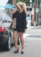 Jessica Simpson wearing a black outfit and matching heels