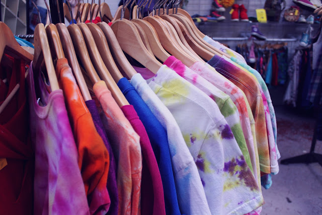 tie-dye t-shirts on a rack