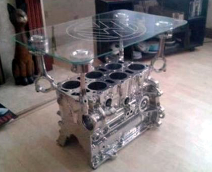 Just a car guy interior decorating with car parts art for the garage