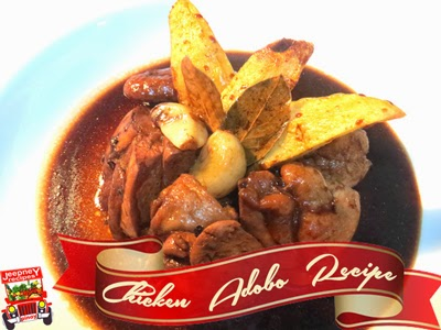 Plated mouthwatering Chicken Adobo with fried potatoes
