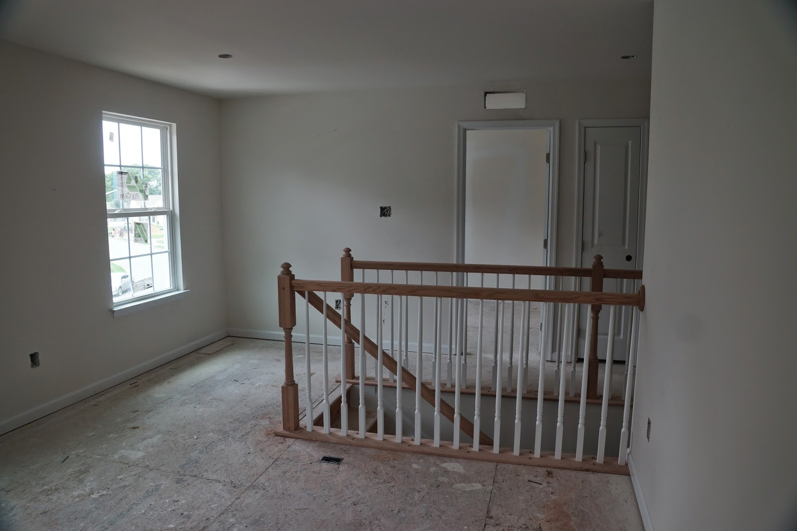 Picture of the unfinished banister on the top of the stairs as viewed from the loft