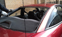 1999 Chevrolet Cavalier coupe receives new windshield due to Hurricane Sandy