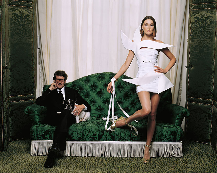 Yves Saint Laurent with Carla Bruni in 1988 photographed by Jean-Marie Perier