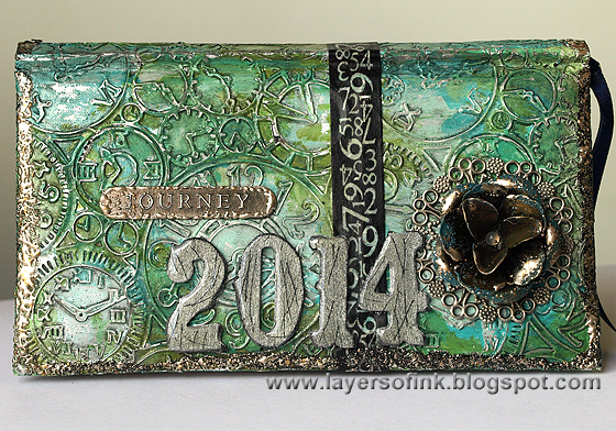 http://layersofink.blogspot.com/2014/01/altered-artsy-almanac.html