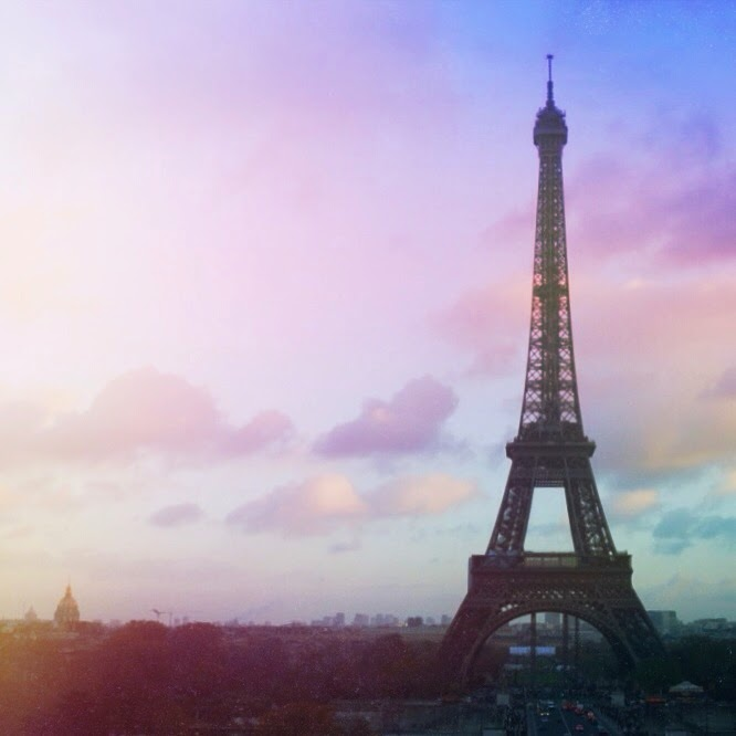pastel skies over the eiffel tower in paris