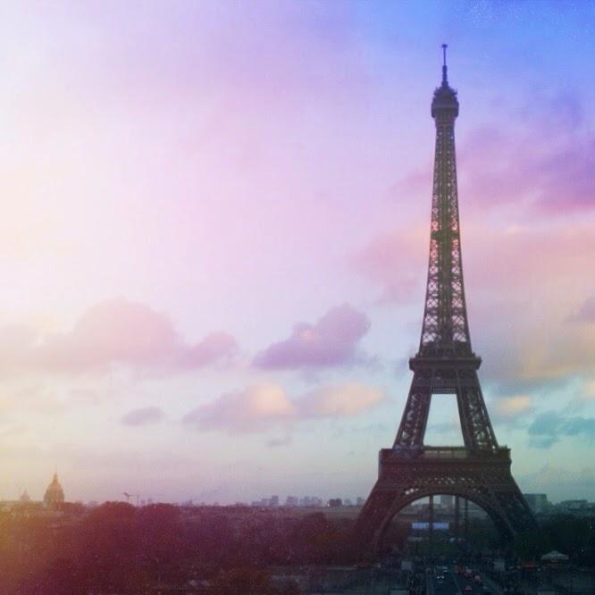 pastel skies over the eiffel tower in paris