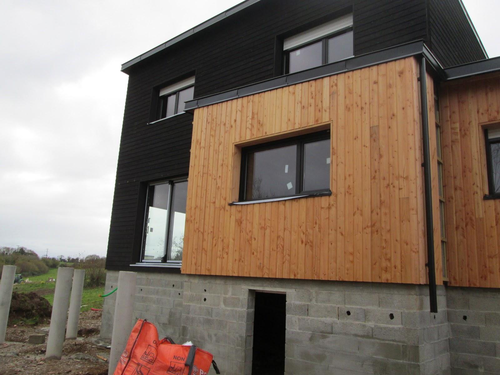 belle maison bois noir de falun