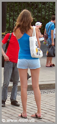 Skinny girl in denim micro shorts on the street