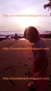 a picture of a sunrise at batu karas