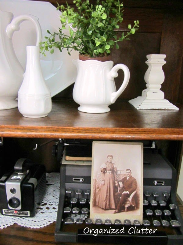 Cameras, Ironstone, & Typewriter Displayed in China Cabinet www.organizedclutterqueen.blogspot.com