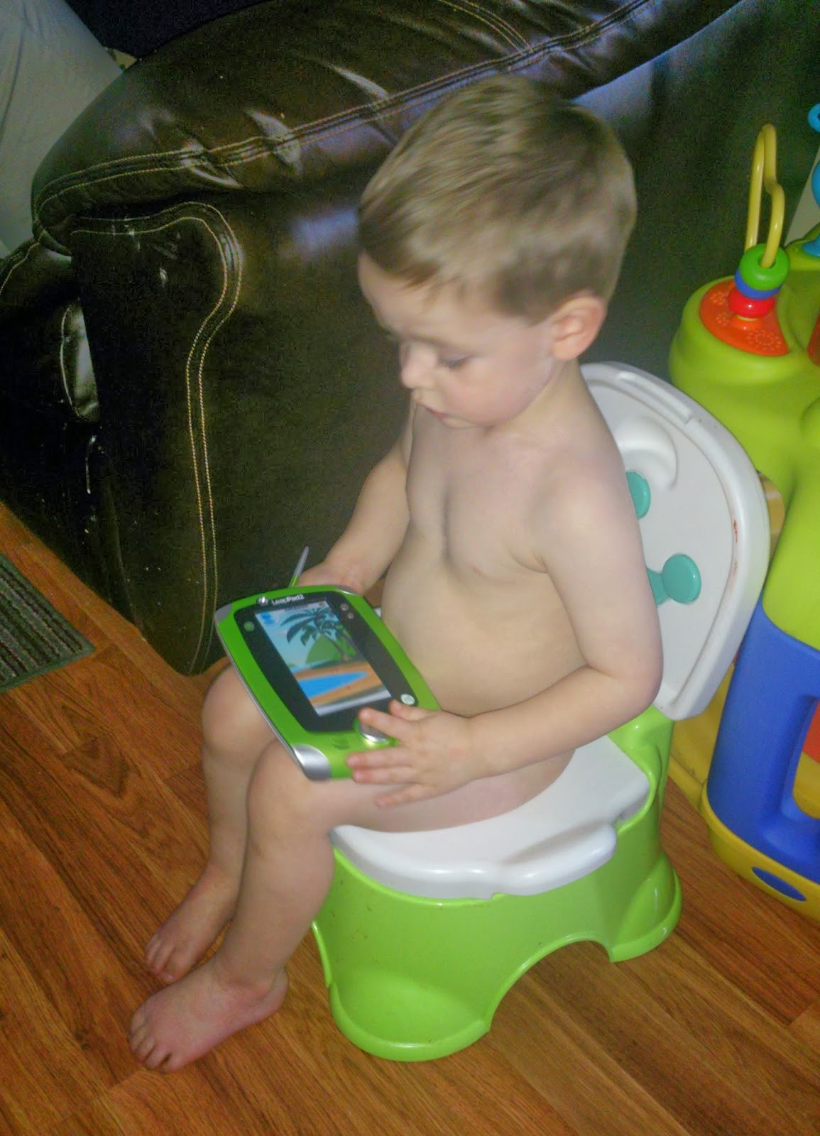 Boy potty training naked