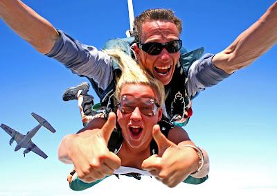 A man and a girl skydiving