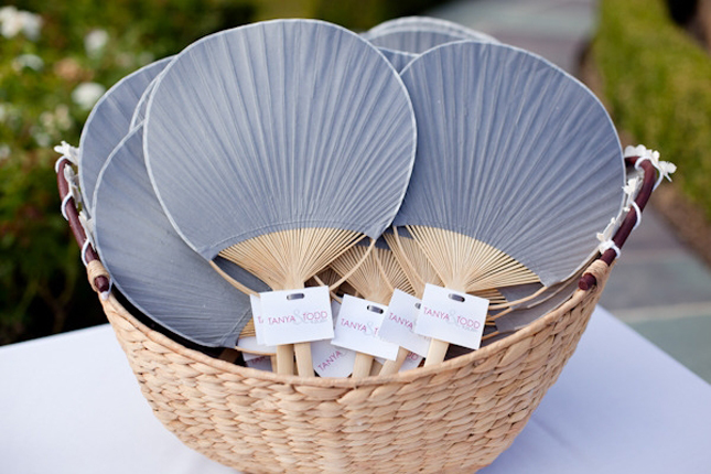 personalized paper fans with the wedding program or a thank you note