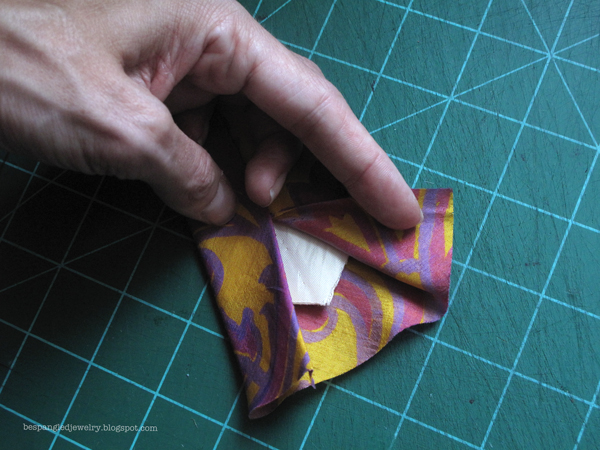 Step 2: Fold back the outer layer of fabric and cut the lining into a point