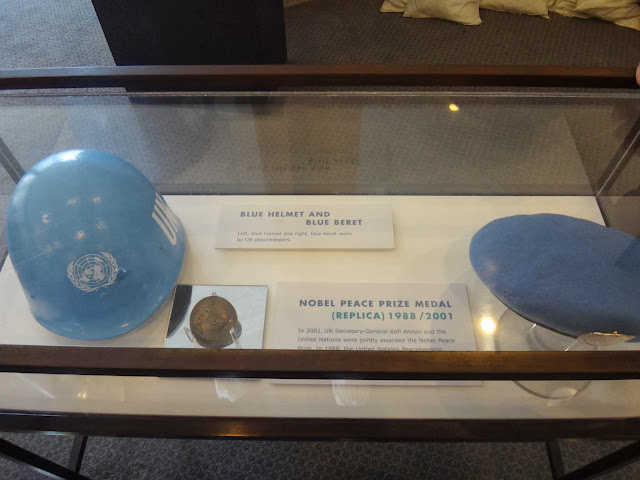 Blue helmet and Blue beret with replica of Nobel Peace Prize at United Nations Headquarter Building in New York, USA