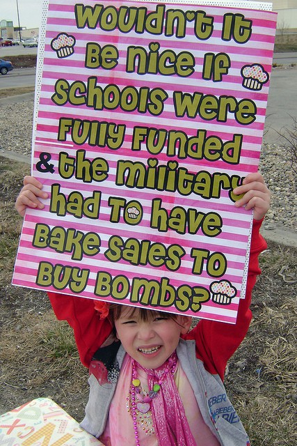Wouldn't It Be Nice If Schools Were Fully Funded And The Military Has To Have Bake Sales To Buy Bomb