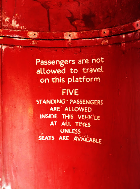 London Bus passenger instructions. Photograph by Tim Irving
