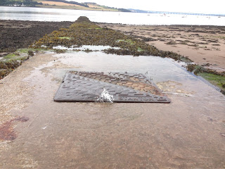 Leaking sewer on Broughty Ferry stony beach at Douglas Terrace