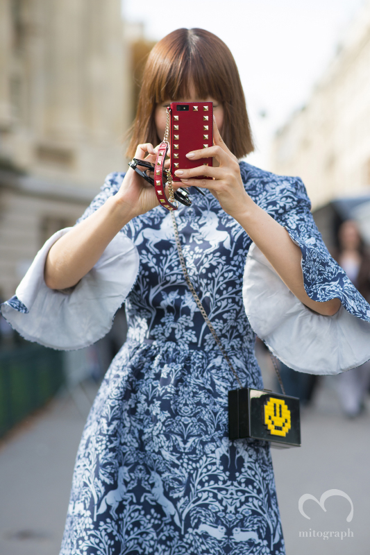 RESTIR Buyer Maiko Shibata wears Mother of Pearl Dress and Les Petits Joueurs Clutch and Valentino Iphone case during Paris Fashion Week 2015 Spring Summer PFW